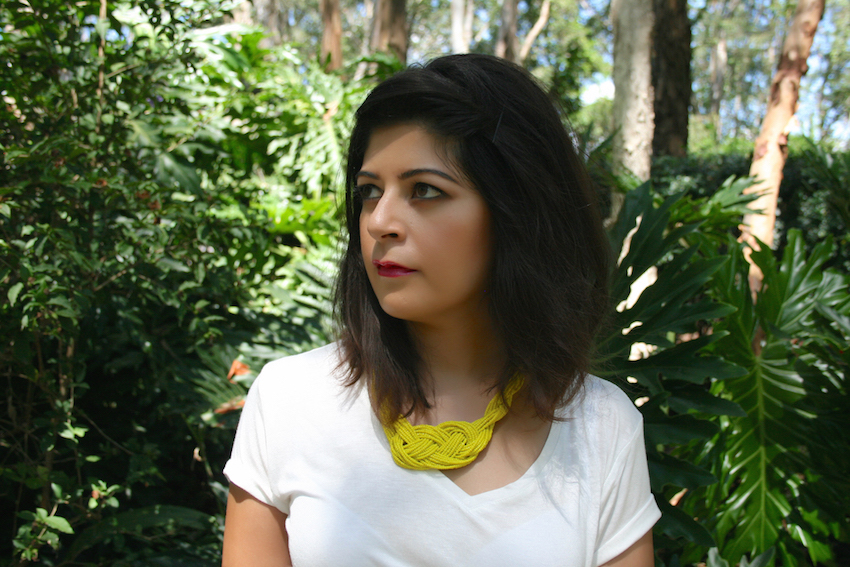 White T Shirt yellow necklace
