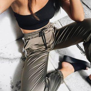 green track pants closeup